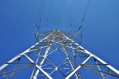 High voltage electricity tower pole below view Stock Images