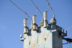 High voltage electricity transformer station against blue sky Royalty Free Stock Photo