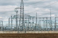 Free High-voltage Electricity Transmission Pylon Power Lines And Towers. Industrial Electricity Distribution Royalty Free Stock Image - 140322456