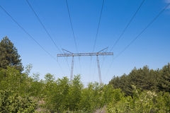 High Voltage Electricity Transmission Pylon Silhouetted Stock Photos