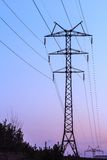 High voltage electricity transmission tower. With powerlines and pylons stock photography