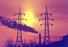 High voltage electricity transmissions line  on a sunset, with a retro effect Royalty Free Stock Photography