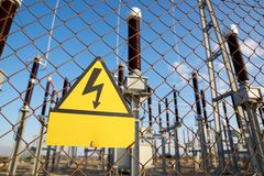 High voltage hazard. Electrical hazard sign placed on a metal fence stock image