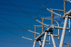 High Voltage Insulators. High Voltage Electrical Substation Insulators with blue sky in background Stock Photos