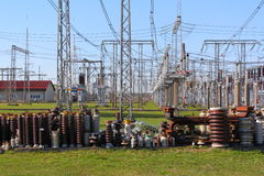 High voltage insulators. Row of high voltage insulators in front of a switch-yard Royalty Free Stock Image