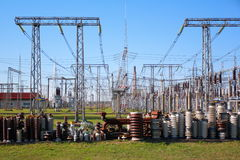 High voltage insulators. Row of high voltage insulators in front of a switch-yard Stock Photos