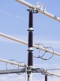 High voltage insulators. Of a power plant Royalty Free Stock Images
