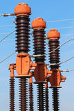 High voltage isolation with ceramic body on blue sky Royalty Free Stock Image