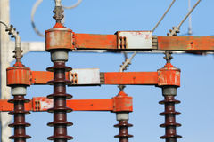 High voltage isolation with ceramic body over blue sky Stock Images