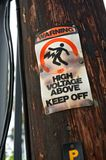 High Voltage-Keep Off Warning Sign Stock Photography