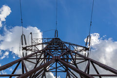 High-voltage line on a background of blue sky with clouds Royalty Free Stock Photos
