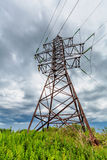 High voltage line and cloudy sky Royalty Free Stock Image