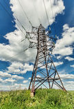 High voltage line and cloudy sky Royalty Free Stock Photography