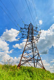 High voltage line and cloudy sky Stock Images