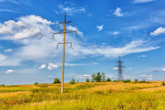 High voltage line and cloudy sky Royalty Free Stock Photos