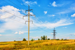 High voltage line and cloudy sky. High voltage line beneath blue cloudy sky Stock Images