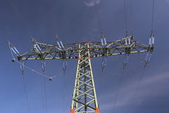 High Voltage Line And Dark Blue Sky Stock Photos