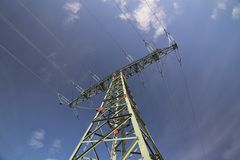 High Voltage Line And Dark Blue Sky Royalty Free Stock Image