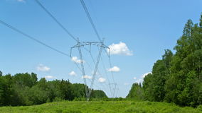 High-voltage line of electricity transmissions on field , among wood. Time lapse. stock footage