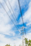 The high-voltage line iron tower. High point in the sky in the background of transmission tower Stock Images