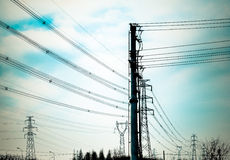 The high-voltage line iron tower. High point in the sky in the background of transmission tower Stock Photo