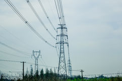 The high-voltage line iron tower. High point in the sky in the background of transmission tower Stock Photography