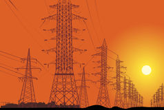 High-voltage line on orange sunset Stock Photos