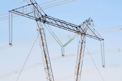 High-voltage line. The high-voltage line passes through the winter forest-steppe of Altai Royalty Free Stock Images