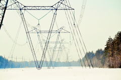High-voltage line. The high-voltage line passes through the winter forest-steppe of Altai Stock Photos