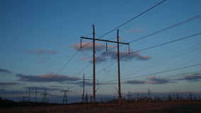 High-voltage Line. Poles With Wires. At Sunset. Time Lapse stock footage
