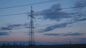 High-voltage Line. Poles With Wires. At Sunset. Time Lapse stock video footage