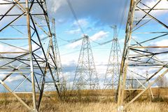 High-voltage line in the sky Stock Photo