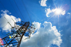 High voltage line and sun in the sky Stock Photos