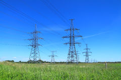 High voltage line support. Against the blue sky Stock Image