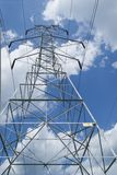 High Voltage Line Tower. High voltage transmission line tower with blue sky and clouds in background in Kettering, Maryland USA royalty free stock images