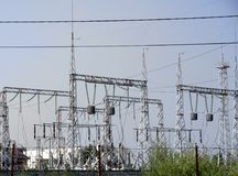 High-voltage lines against the background of electrical distribution stations at sunrise. High-voltage lines against the background of electrical distribution stock photography