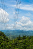 High voltage lines beneath the blue cloudy sky Royalty Free Stock Photography