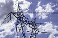 High voltage lines beneath the blue cloudy sky Royalty Free Stock Photo