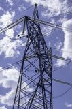 High voltage lines beneath the blue cloudy sky Stock Photography