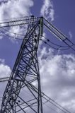 High voltage lines beneath the blue cloudy sky Stock Photo