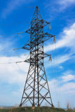 High voltage lines and blue cloudy sky Stock Image