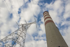 High voltage lines and chimney Stock Photo