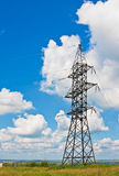 High voltage lines and cloudy sky Stock Images