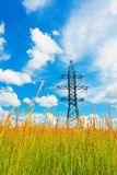 High voltage lines and cloudy sky Royalty Free Stock Image