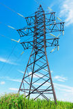 High voltage lines and cloudy sky Stock Photo