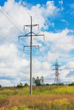 High voltage lines and cloudy sky Stock Photos