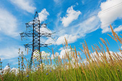 High voltage lines and cloudy sky Royalty Free Stock Photo