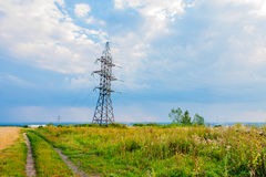 High voltage lines and cloudy sky Stock Image