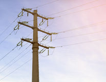 High-voltage lines. Construction of high-voltage lines on the background before sunset sky Stock Image
