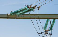 High voltage lines and a insulators from close Royalty Free Stock Photography